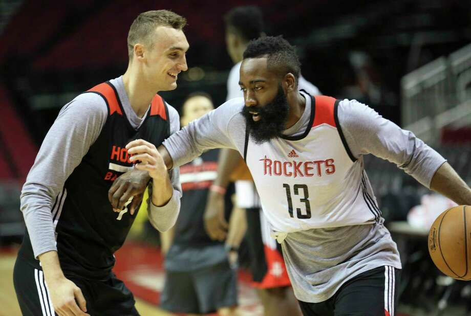 Forward Sam Dekker, left, and James Harden enjoy a light moment at practice at Toyota Center on Friday. Dekker, who missed four weeks with a fractured left hand, says he'll be available to play against the Spurs.  Photo: Yi-Chin Lee, Staff / © 2017  Houston Chronicle