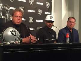 Raiders GM Reggie Mckenzie (left) and Raiders Coach Jack Del Rio (right) with the Raiders first round selection of the NFL Draft, Gareon Conley on Friday April 28, 2017 at Oakland Alameda Coliseum in Oakland, Calif.