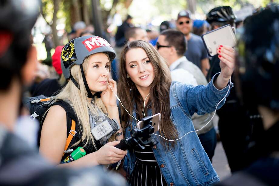 Far-right personalities Lauren Southern (left) and Brittany Pettibone broadcast from a rally in Berkeley. Photo: Noah Berger, Special To The Chronicle