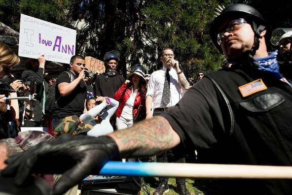 Conservative speaker Gavin McInnes, co-founder of Vice Media, speaks during a rally at Martin Luther King Jr. Civic Center Park on Thursday, April 27, 2017, in Berkeley, Calif. McInnes read a speech he said Ann Coulter's had planned to deliver in Berkeley today.