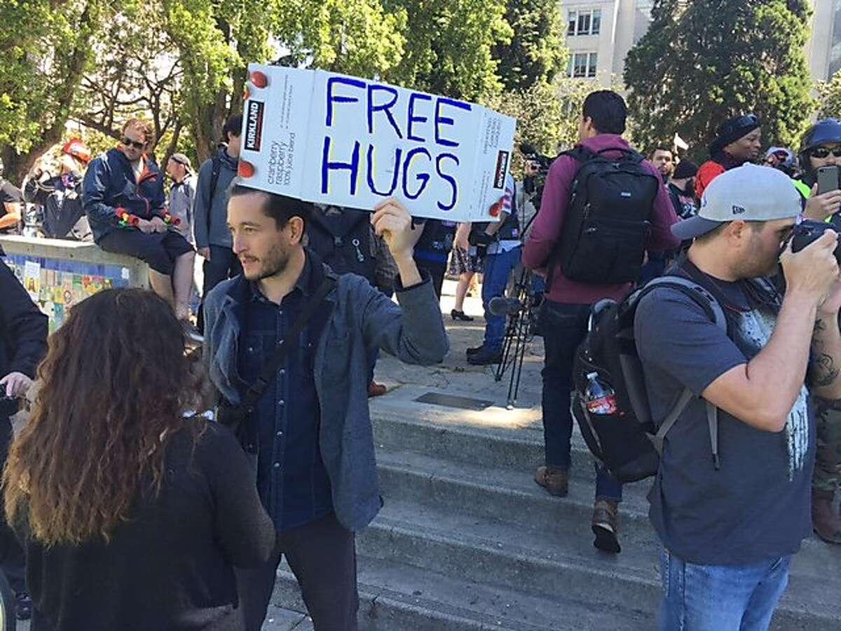 Counter-demonstrator Gabriel Diamond offers