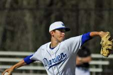 Darien's Henry Williams throws a pitch during a game against Ridgefield Friday.