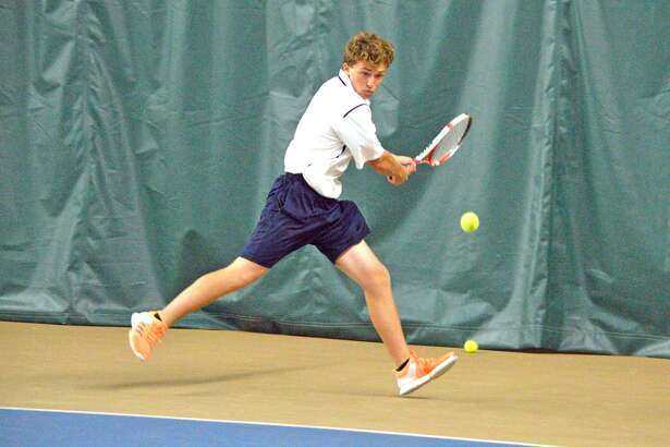Edwardsville sophomore Nick Hobin makes a forehand return on Friday during his No. 2 singles match against Jefferson City, Mo., at the Meyer Center YMCA.