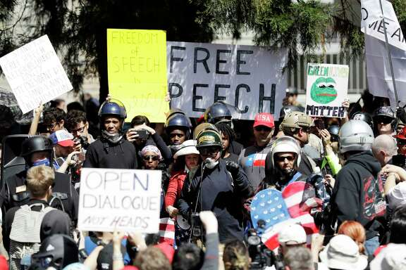 A crowd gathers around speakers during a rally for free speech in Berkeley, Calif. (AP Photo/Marcio Jose Sanchez)