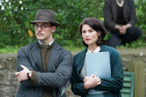 """In this image released by STX Entertainment, Sam Clafin, left, and Gemma Arterton appear in a scene from, """"Their Finest"""". (Nicola Dove/STX Entertainment via AP) ORG XMIT: NYET711"""