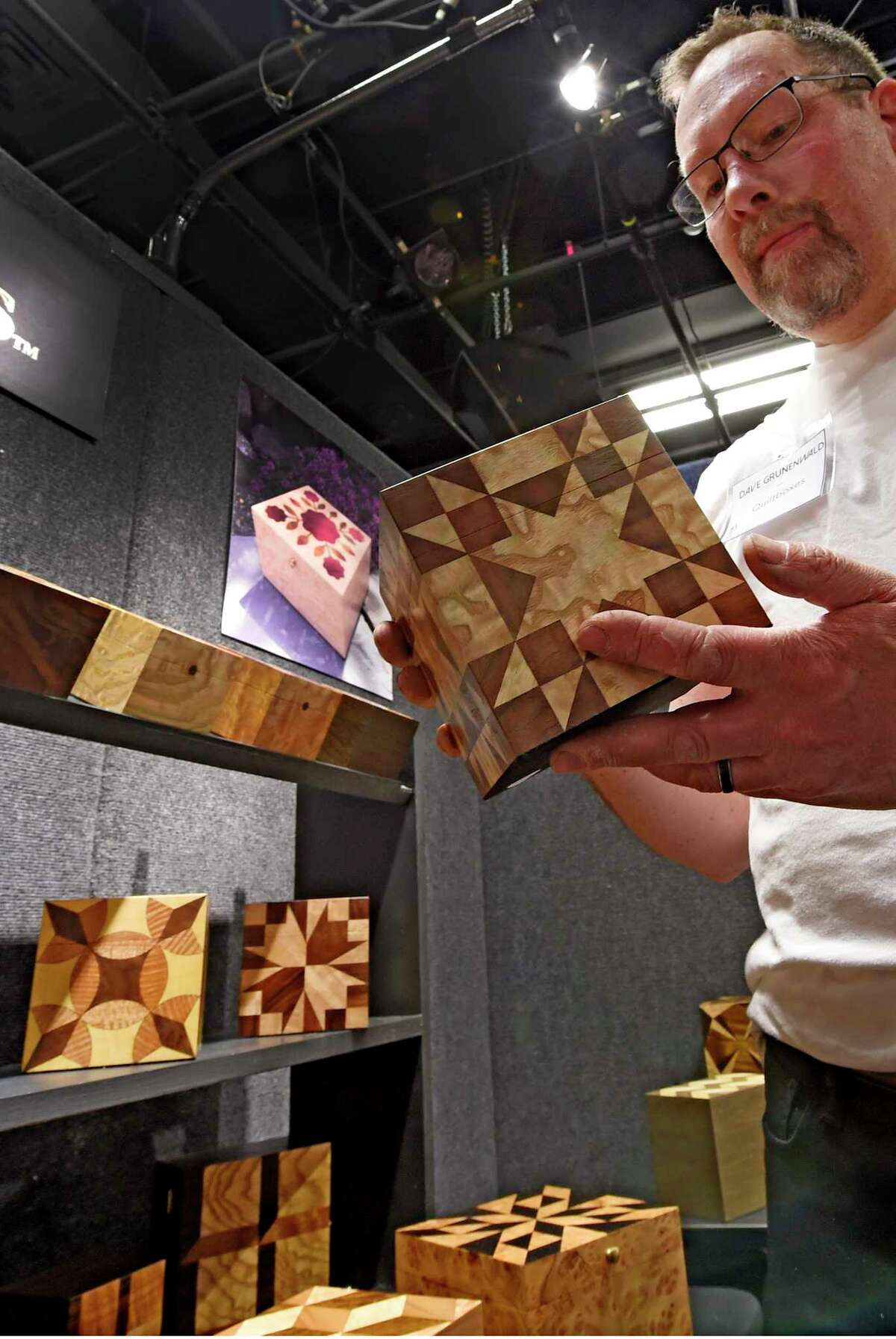 Dave Grunenwald of Quiltboxes of Poestenkill shows off his handiwork as the Collar City Craft Fest opens at the Arts Center of the Capital Region Friday April 28, 2017 in Troy, N.Y. (Skip Dickstein/Times Union)