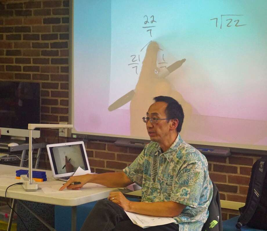 Education consultant Greg Tang leads a workshop on math for elementary students for Greenwich Public School teachers on Wednesday. Photo: Contributed