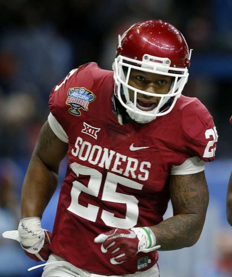 Joe Mixon celebrates his touchdown against Auburn in the first half of January's Sugar Bowl. Mixon, a Freedom-Oakley alum, was drafted by the Cincinnati Bengals on Friday. Photo: Gerald Herbert, Associated Press