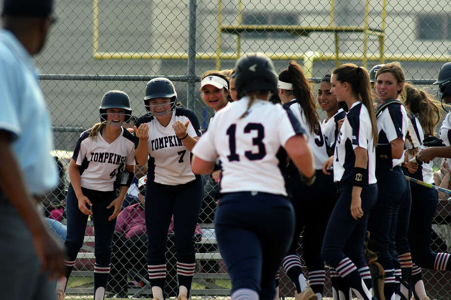 Tompkins sophomre Kendall McGary, from left, and junior Zoe Pruden lead the greeting party at home plate for teammate Mackenzie Brown after Brown's grand slam in the top of the first inning against Kempner in game two of their Region III-6A Bi-District Softball playoff series match-up at Kempner High School on Friday, April 28, 2017. (Photo by Jerry Baker/Freelance) Photo: Jerry Baker/For The Chronicle