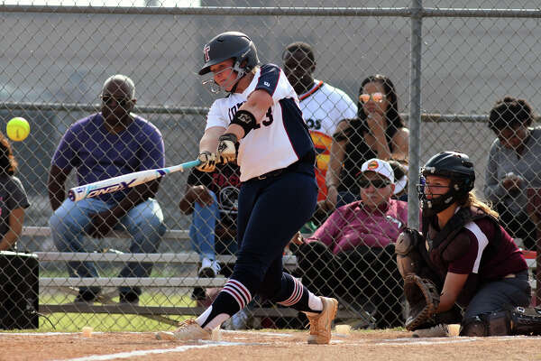 Tompkins junior Mackenzie Brown drives a ball over the centerfield fence for a grand slam in the top of the first inning against Kempner in game two of their Region III-6A Bi-District Softball playoff series match-up at Kempner High School on Friday, April 28, 2017. (Photo by Jerry Baker/Freelance)