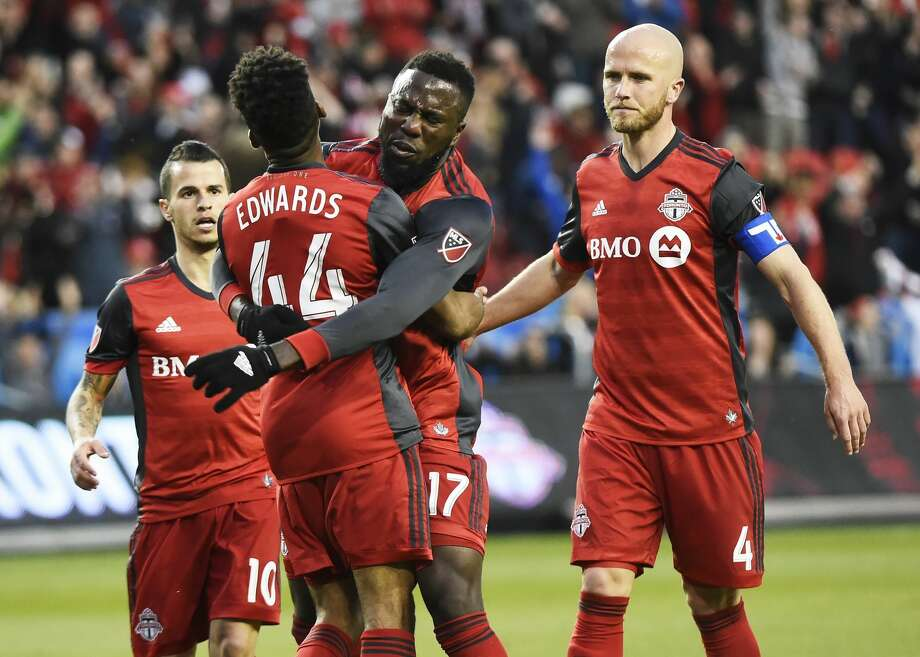 Toronto FC forward Raheem Edwards (44) celebrates with Jozy Altidore (17), Sebastian Giovinco (10) and Michael Bradley (4) after Altidore scored against the Houston Dynamo during the first half of an MLS soccer match in Toronto on Friday, April 28, 2017. (Nathan Denette/The Canadian Press via AP) Photo: Nathan Denette/Associated Press