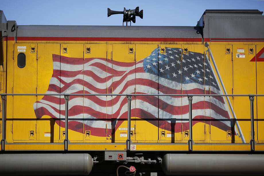 An American flag is painted on the side of a Union Pacific Corp. freight locomotive in St. Louis. Photo: Luke Sharrett, Bloomberg