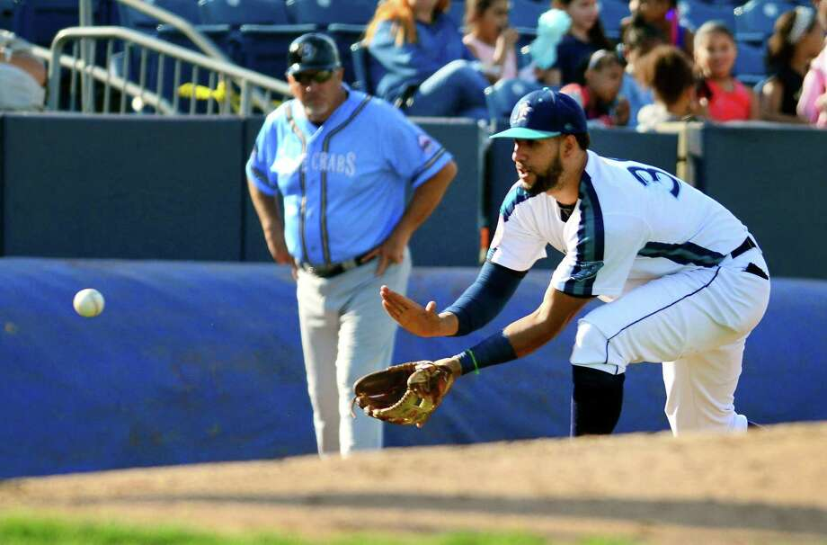 Bluefish third baseman Jose Cuevas fields a hit to him by Southern Maryland Blue Crabs' Gary Brown during opening day baseball action at the Ballpark at Harbor Yard in Bridgeport, Conn., on Friday Apr. 28, 2017. Photo: Christian Abraham / Hearst Connecticut Media / Connecticut Post