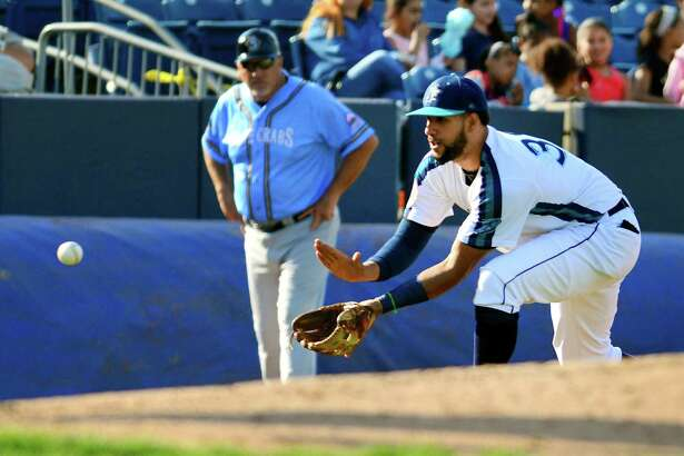 Bluefish third baseman Jose Cuevas fields a hit to him by Southern Maryland Blue Crabs' Gary Brown during opening day baseball action at the Ballpark at Harbor Yard in Bridgeport, Conn., on Friday Apr. 28, 2017.
