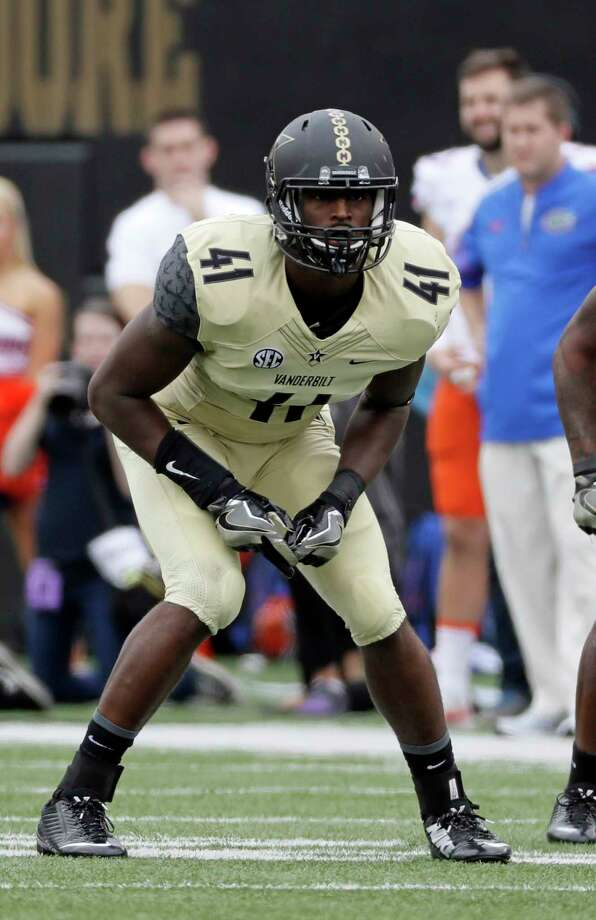 FILE - In this Oct. 1, 2016, file photo, Vanderbilt linebacker Zach Cunningham plays against Florida during an NCAA college football game in Nashville, Tenn. Cunningham has been among the nation's most productive defensive players and earned first-team AP All-America honors after making 119 tackles, including 16½ for a loss. Vanderbilt plays North Carolina State in the Independence Bowl on Monday. (AP Photo/Mark Humphrey, File) Photo: Mark Humphrey, STF / Copyright 2016 The Associated Press. All rights reserved.