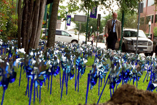 Residents walking around downtown Conroe could take in the site of 1,169 blue pinwheels in the ground near the Alan B. Sadler Commissioners Court Building Conroe in recognition of Child Abuse Awareness Month, Tuesday, April 25, 2017, Tuesday, April 25, 2017.