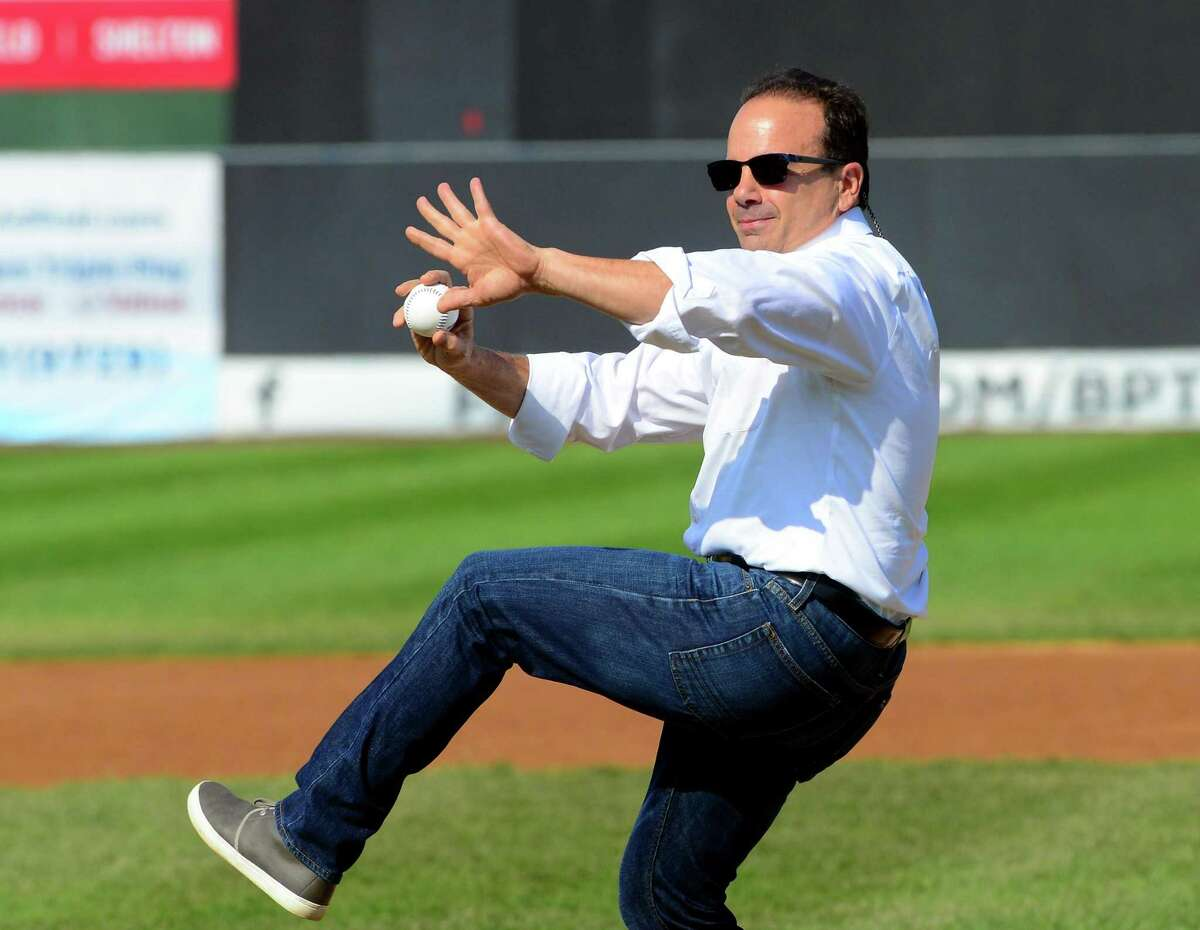 Mayor Joe Ganim throws out the ceremonial first pitch during the opening day of Bluefish baseball at the Ballpark at Harbor Yard in Bridgeport, Conn., on Friday Apr. 28, 2017.