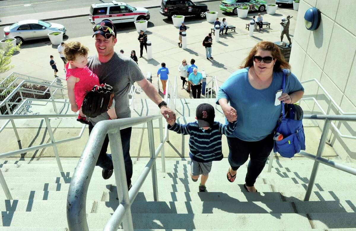 The Bedell family, of Stratford, climb the stairs to go into see the opening day of Bluefish baseball at the Ballpark at Harbor Yard in Bridgeport, Conn., on Friday Apr. 28, 2017. From left to right is Matt Bedell with daughter Kinley, 20 months, son Mason, 5, and mom Kristen.