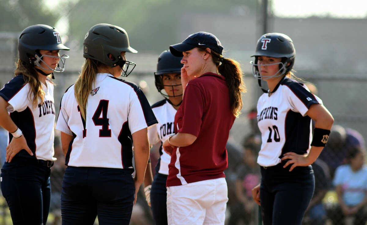 Tompkins Head Coach Katy Agiannidis, center, pumps up senior Macy Moore, from left, freshman Kennedy Carter, freshman Kat Ibarra, and junior Kaitlynn Kinslow during a pitching change by Kempner in the top of the third inning of their Region III-6A Bi-District Softball playoff series match-up at Kempner High School on Friday, April 28, 2017. (Photo by Jerry Baker/Freelance)