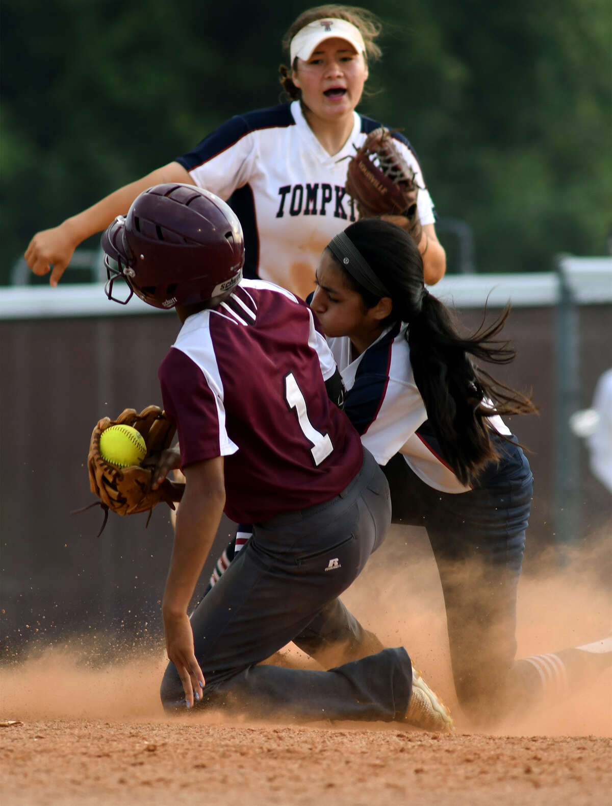 Tompkins freshman shortstop Kat Ibarra, right, puts the tag on Kempner baserunner Star Ferguson after she strayed too far away from the 2nd base bag on a play in the bottom of the 5th inning in game two of their Region III-6A Bi-District Softball playoff series match-up at Kempner High School on Friday, April 28, 2017. (Photo by Jerry Baker/Freelance)