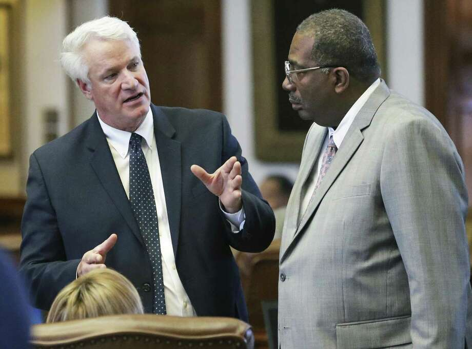 Representative Lyle Larson, R-San Antonio, talks with Senator Royce West, D-Dallas, who came over to the house for a conversation as members debate legislation in the House of Representatives on April 27, 2017. Photo: Tom Reel, Staff / San Antonio Express-News / 2017 SAN ANTONIO EXPRESS-NEWS