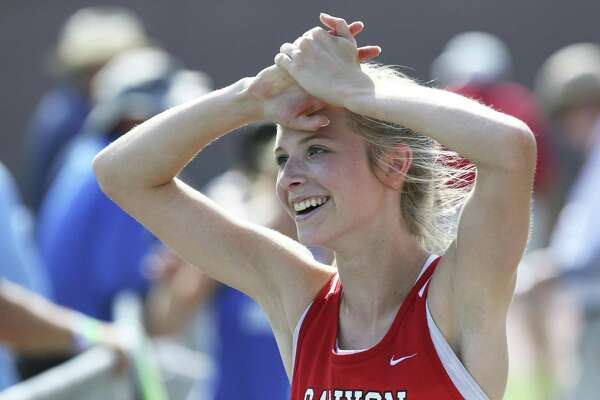 Canyon's Olivia Buntin feels the exhileration after winning a medal at the Region IV-6A track an field championships at Alamo Stadium on April 28, 2017.