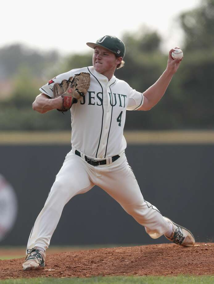 Strake Jesuit pitcher Riley Overstreet delivers a pitch in the third inning during the high school baseball game between the Katy Taylor Mustangs and the Strake Jesuit Crusaders at Markle Steel Field at Strake Jesuit High School on Friday, April 28, 2017 in Houston, TX. Photo: Tim Warner/For The Chronicle
