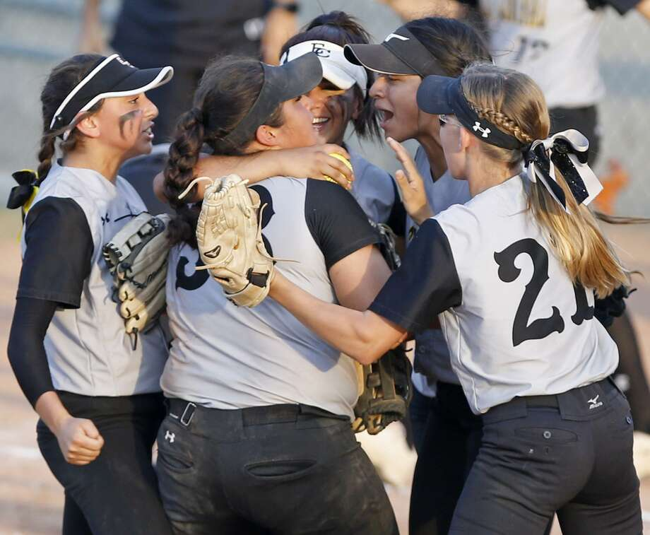 Members of the East Central softball team celebrate their 9-5 win over O'Connor in Game 2 of their bi-district series. Photo: Edward A. Ornelas /San Antonio Express-News / © 2017 San Antonio Express-News