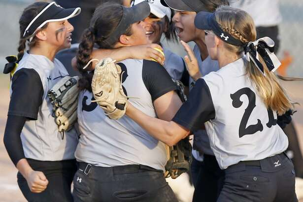 Members of the East Central softball team celebrate their 9-5 win over O'Connor in Game 2 of their Class 6A bidistrict series held Friday April 28, 2017 at Northside Field No. 2.
