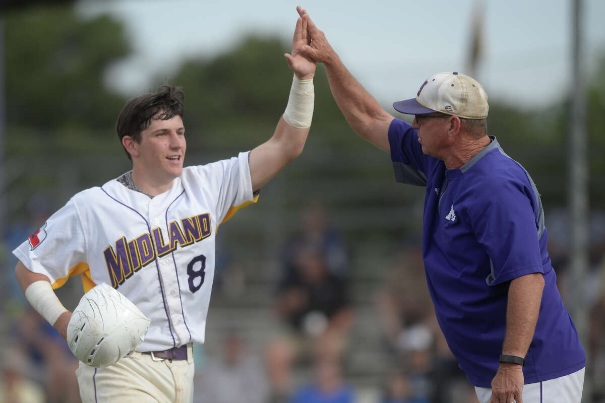 Midland High's Sam Matchus (8) is congratulated by head coach Barry Russell after a run-scoring hit during the game Frenship on April 28, 2017, at Zachery Field. James Durbin/Reporter-Telegram