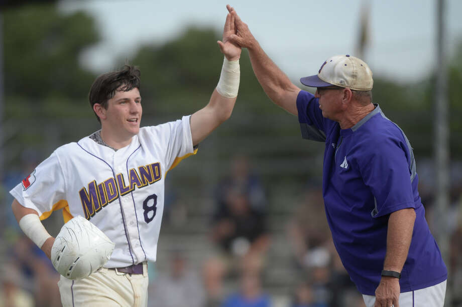 Midland High's Sam Matchus (8) is congratulated by head coach Barry Russell after a run-scoring hit during the game Frenship on April 28, 2017, at Zachery Field.  James Durbin/Reporter-Telegram Photo: James Durbin
