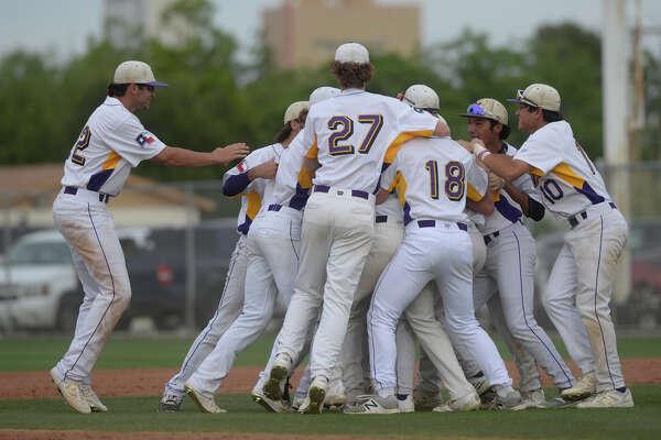 Midland High baseball players celebrate a win against Frenship on April 28, 2017, at Zachery Field.  James Durbin/Reporter-Telegram