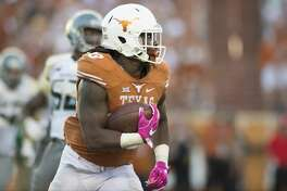 AUSTIN, TX - OCTOBER 29:  D'Onta Foreman #33 of the Texas Longhorns breaks free against the Baylor Bears during the second half on October 29, 2016 at Darrell K Royal-Texas Memorial Stadium in Austin, Texas.  (Photo by Cooper Neill/Getty Images)