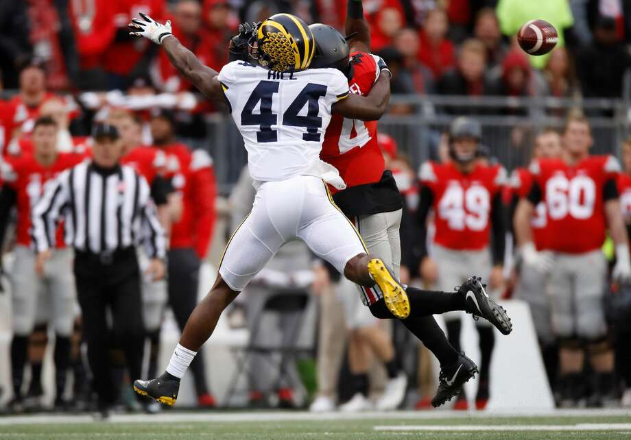 Delano Hill #44 of the Michigan Wolverines breaks up a pass to Curtis Samuel #4 of the Ohio State Buckeyes during the fourth quarter of their game at Ohio Stadium on November 26, 2016 in Columbus, Ohio. Photo: Gregory Shamus/Getty Images