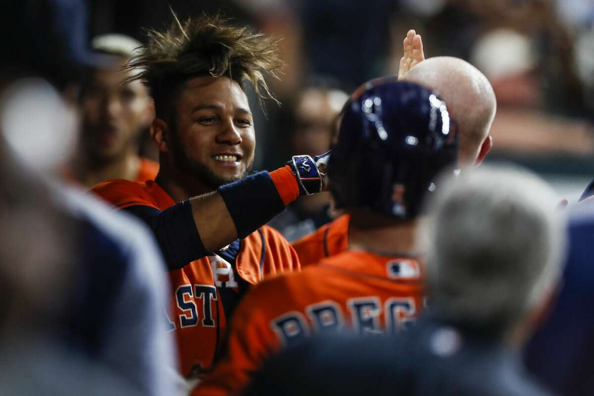 Houston Astros first baseman Yuli Gurriel (10) is welcomed back into the dugout after scoring during the fifth inning as the Houston Astros take on the Oakland Athletics at Minute Maid Park Friday, April 28, 2017 in Houston. ( Michael Ciaglo / Houston Chronicle)