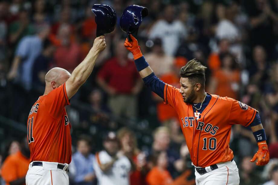 Houston Astros catcher Evan Gattis (11) congratulates first baseman Yuli Gurriel (10) on his home run during the seventh inning as the Houston Astros take on the Oakland Athletics at Minute Maid Park Friday, April 28, 2017 in Houston. ( Michael Ciaglo / Houston Chronicle) Photo: Michael Ciaglo/Houston Chronicle