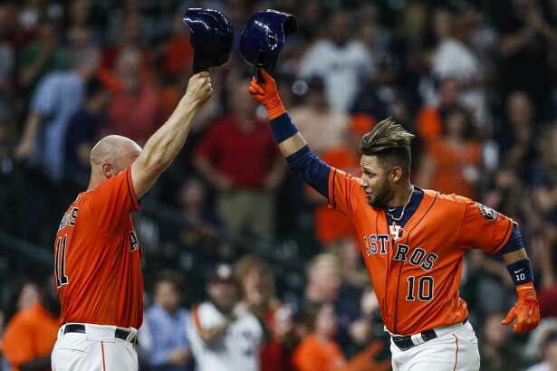 Houston Astros catcher Evan Gattis (11) congratulates first baseman Yuli Gurriel (10) on his home run during the seventh inning as the Houston Astros take on the Oakland Athletics at Minute Maid Park Friday, April 28, 2017 in Houston. ( Michael Ciaglo / Houston Chronicle)