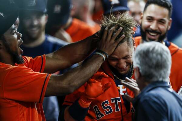 Houston Astros right fielder Teoscar Hernandez (35) rustles first baseman Yuli Gurriel's hair after Gurriel hit a home run during the seventh inning as the Houston Astros take on the Oakland Athletics at Minute Maid Park Friday, April 28, 2017 in Houston. ( Michael Ciaglo / Houston Chronicle)
