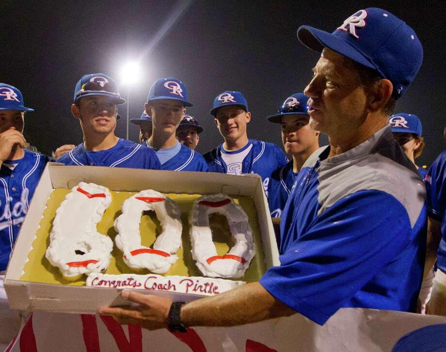 Oak Ridge coach Mike Pirtle is seen holding a celebratory cake after winning his 600th game.   is seen after the War Eagles defeated Montgomery 8-0 for Pirtle's 600th career win, Friday, April 28, 2017, in Oak Ridge. Photo: Jason Fochtman, Staff Photographer / © 2017 Houston Chronicle