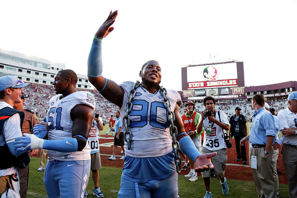 TALLAHASSEE, FL - OCTOBER 1: Defensive Tackle Nazair Jones #90 of the North Carolina Tar Heels wears a chain while celebrating with teammates after the game against the Florida State Seminoles at Doak Campbell Stadium on Bobby Bowden Field on October 1, 2016 in Tallahassee, Florida. North Carolina upset the 12th ranked Florida State 37 to 35. (Photo by Don Juan Moore/Getty Images)