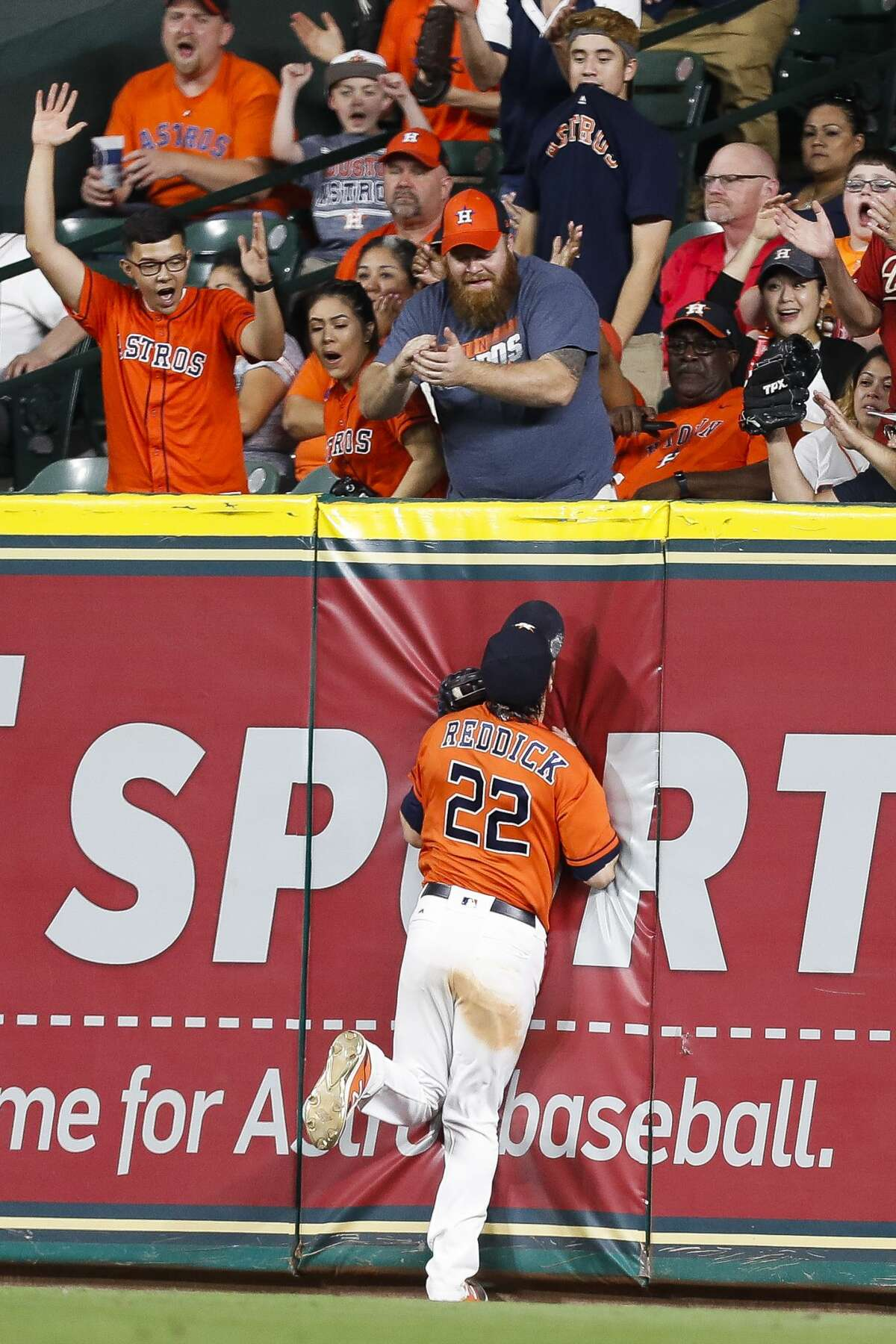 Houston Astros left fielder Josh Reddick (22) catches a fly ball to get the third out with two runners on base during the eighth inning as the Houston Astros take on the Oakland Athletics at Minute Maid Park Friday, April 28, 2017 in Houston. ( Michael Ciaglo / Houston Chronicle)