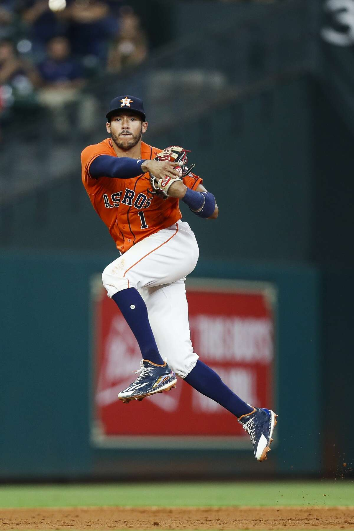 Houston Astros shortstop Carlos Correa (1) throws the final out during the ninth inning as the Houston Astros take on the Oakland Athletics at Minute Maid Park Friday, April 28, 2017 in Houston. ( Michael Ciaglo / Houston Chronicle)