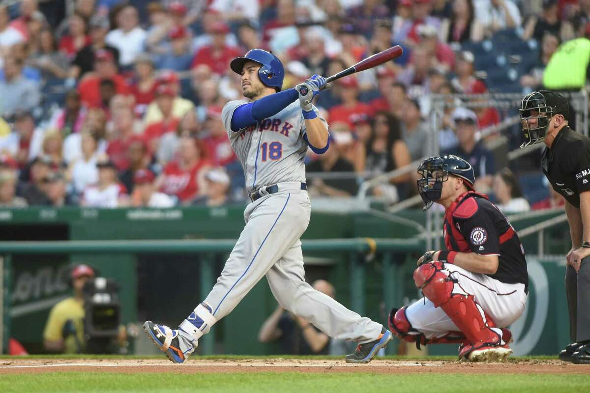 WASHINGTON, DC - APRIL 28: Travis d'Arnaud #18 of the New York Mets hits a two run home run in the second inning during a baseball game against the Washington Nationals at Nationals Park on April 28, 2017 in Washington, DC. (Photo by Mitchell Layton/Getty Images) ORG XMIT: 700010564