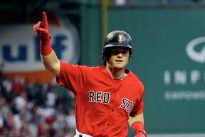 Boston Red Sox's Andrew Benintendi gestures as he crosses the plate with a solo home run during the first inning of the team's baseball game against the Chicago Cubs at Fenway Park, Friday, April 28, 2017, in Boston. (AP Photo/Elise Amendola) ORG XMIT: MAEA104