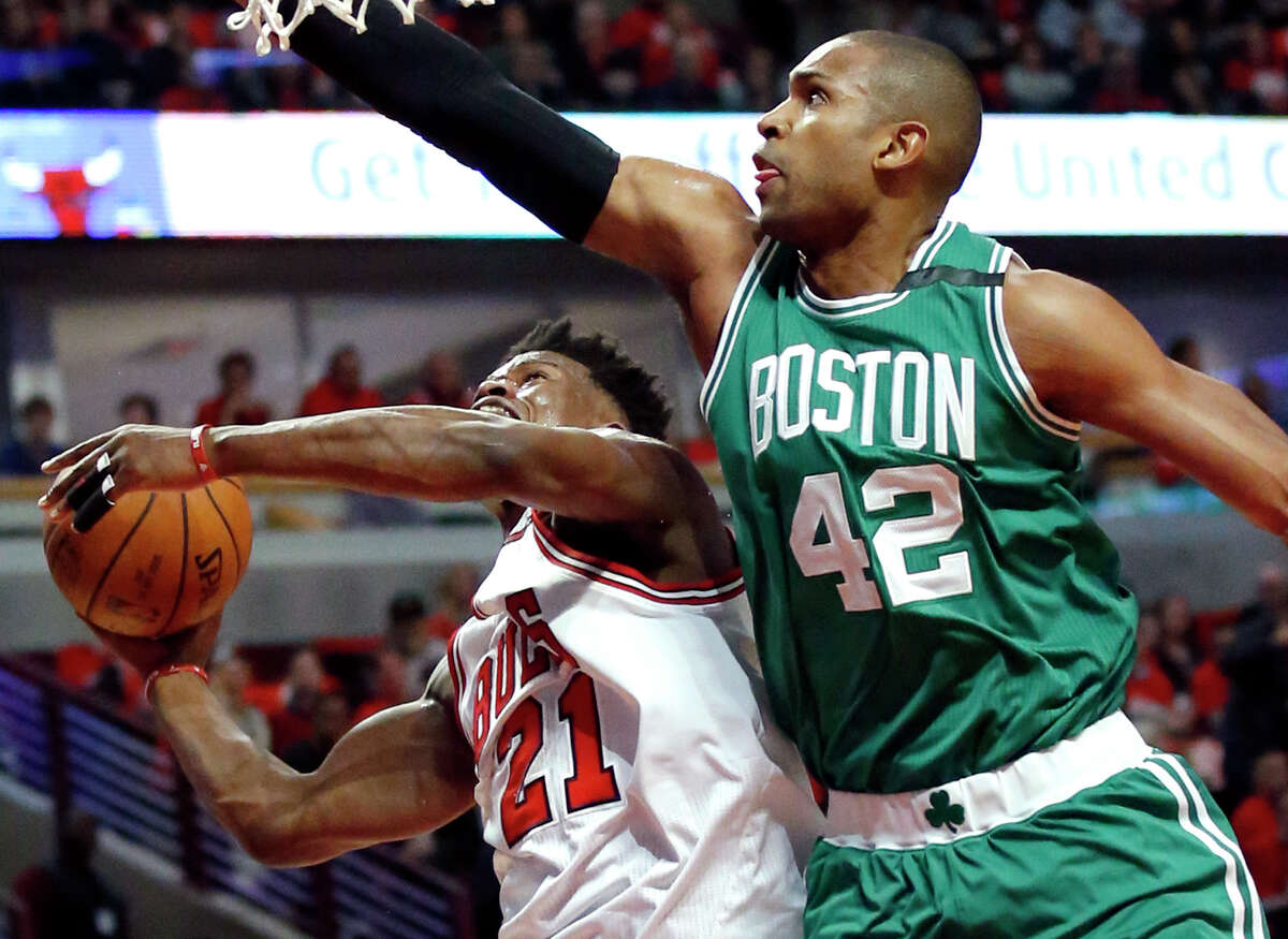 Chicago Bulls' Jimmy Butler, left, drives to the basket against Boston Celtics' Al Horford during the first half in Game 6 of an NBA basketball first-round playoff series, Friday, April. 28, 2017, in Chicago. (AP Photo/Nam Y. Huh) ORG XMIT: CXA107