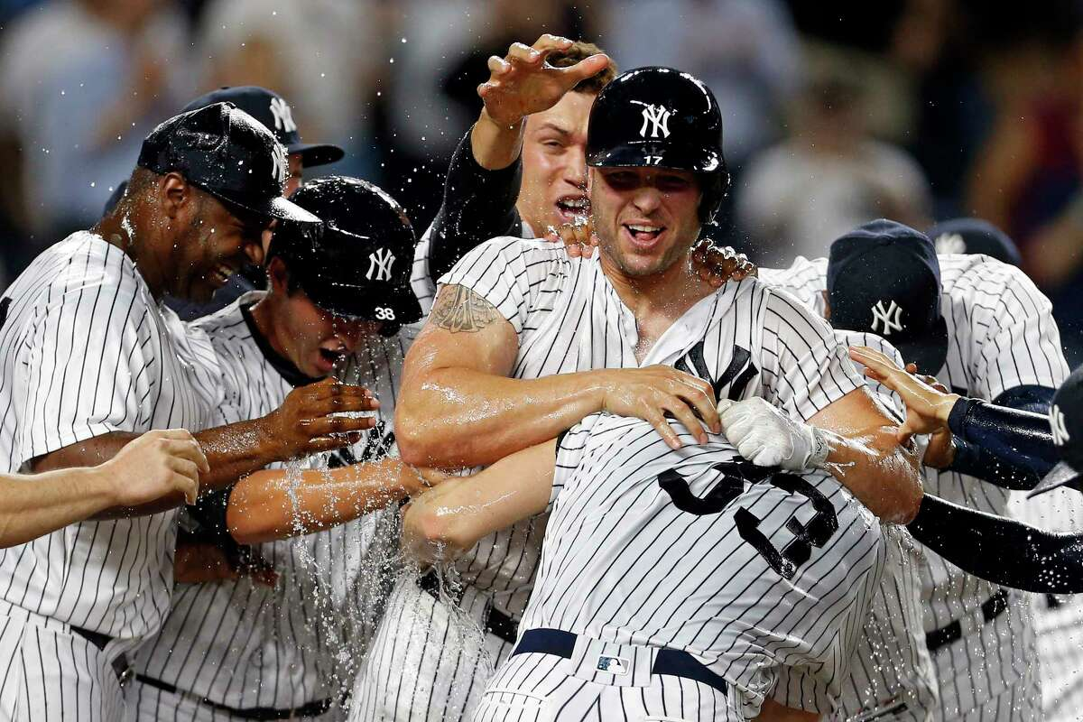 NEW YORK, NY - APRIL 28: Matt Holliday #17 of the New York Yankees is congratulated by teammates after hitting the game winning 3-run home run against the Baltimore Orioles during the tenth inning at Yankee Stadium on April 28, 2017 in the Bronx borough of New York City. The Yankees won 14-11. (Photo by Adam Hunger/Getty Images) ORG XMIT: 700010562