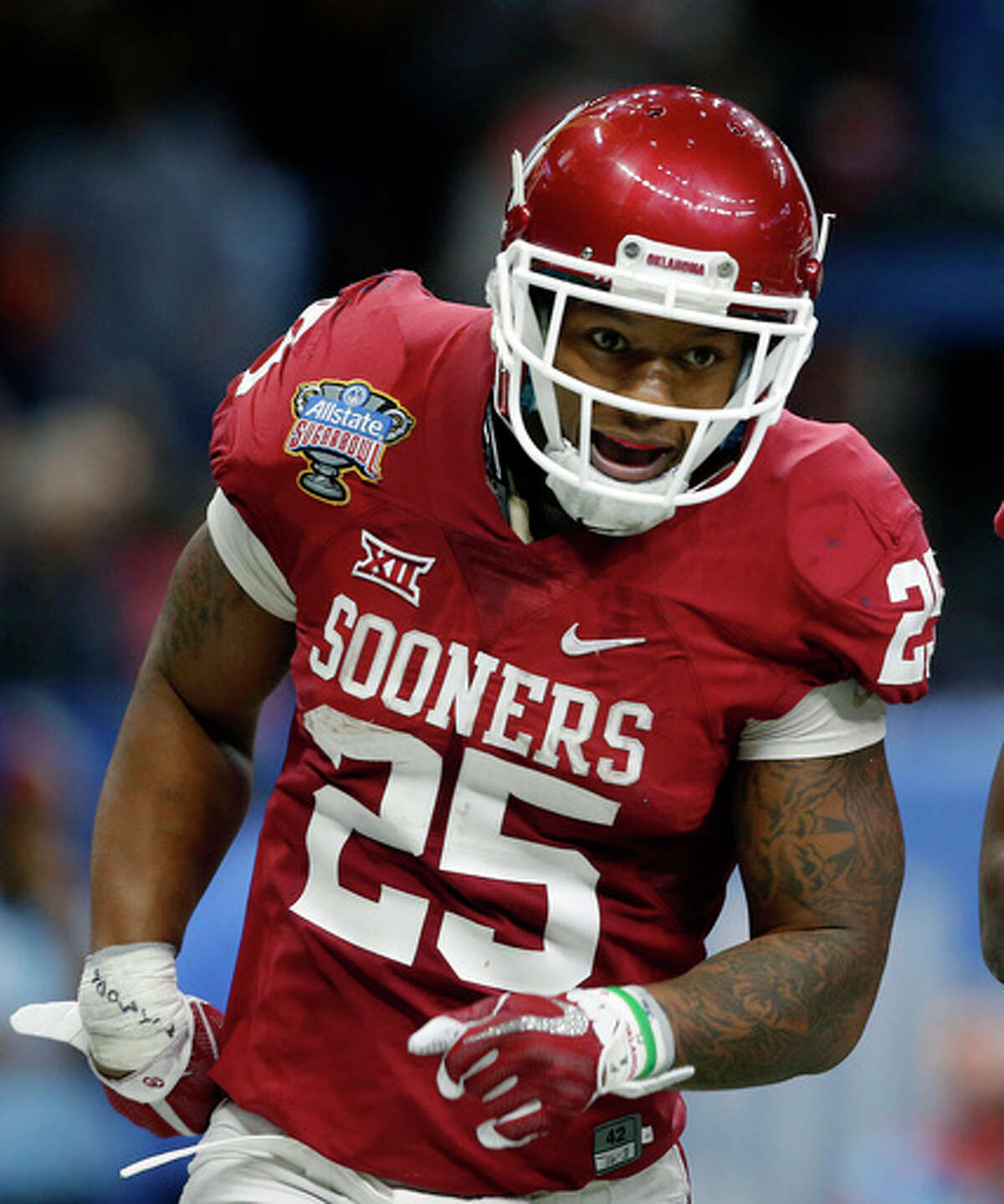 FILE - In this Jan. 2, 2017, file photo, Oklahoma running back Joe Mixon (25) celebrates his touchdown against Auburn in the first half of the Sugar Bowl NCAA college football game in New Orleans. Fans in the NFL draft theater booed when Mixon, who was uninvited to the scouting combine because of a domestic assault incident from 2014, was announced as the Cincinnati Bengals' pick at No. 48 overall Friday, April 28, 2017. (AP Photo/Gerald Herbert, File) ORG XMIT: NY901