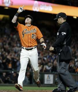 San Francisco Giants' Christian Arroyo celebrates after hitting a home run off San Diego Padres' Ryan Buchter during the eighth inning of a baseball game Friday, April 28, 2017, in San Francisco. (AP Photo/Ben Margot)