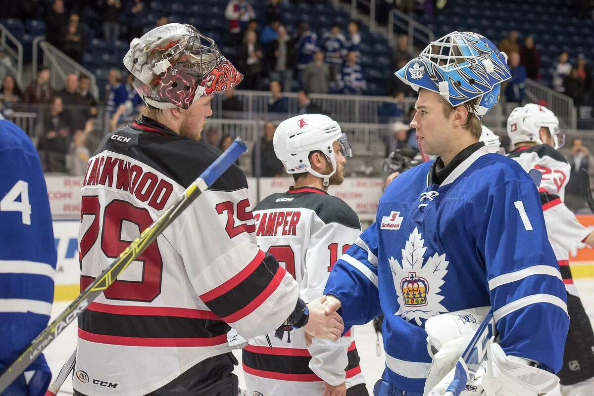 Albany goalie Mackenzie Blackwood and Toronto goalie Kasimir Kaskisuo shake hands after their epic battle in Game 4 of their first-round AHL playoff series on Friday, won by the Marlies 2-1 in triple overtime. Blackwood made 58 saves in the contest. (Courtesy of Toronto Marlies)