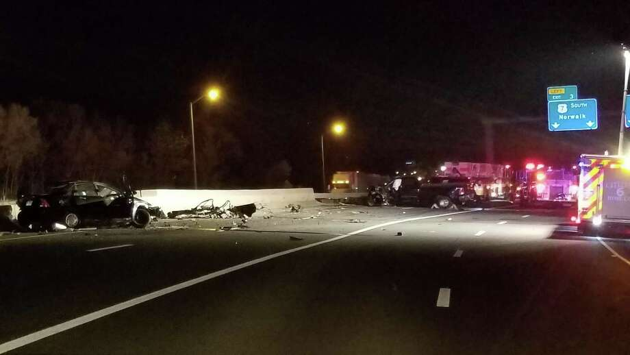 A collision between a car and a pickup truck Friday night left one person dead and caused part of Interstate 84 to be closed down. Photo: Danbury Fire Department /Danbury Fire Department